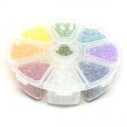 Boite 8 compartiments Perles de rocailles en demi baton transparentes - 2,2 mm