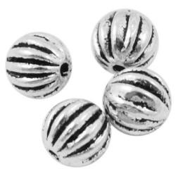 Perle de métal ronde décorée avec traits
