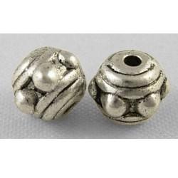 Perle de métal ronde décorée, argentée
