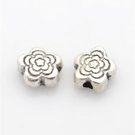 Perle de métal petit papillon