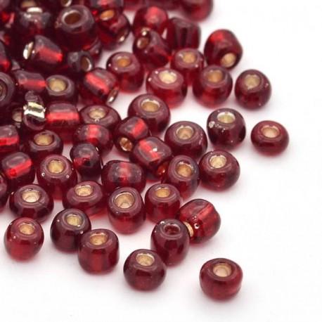 Sachet 50 gr perles de rocaille rouge foncé transparentes avec liseré - 3 mm